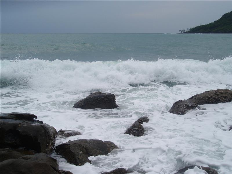 Watching the waves crash against the rocks at the far southern end of the beach