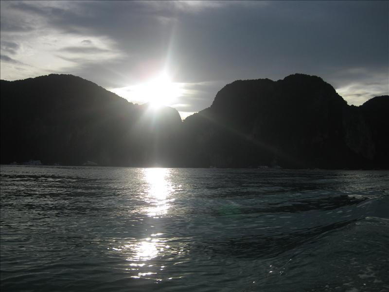 Sun setting behind mountains on Ko Phi Phi