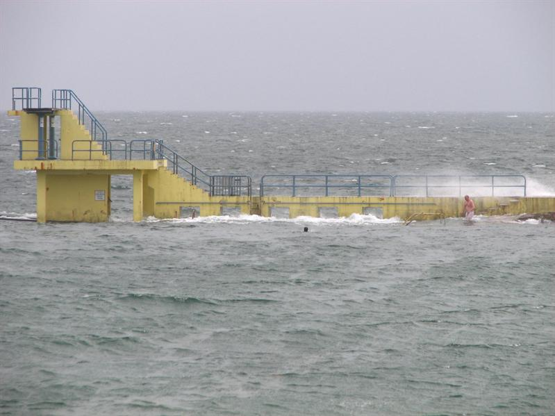 Swimming facility right in the ocean-notice the guy?