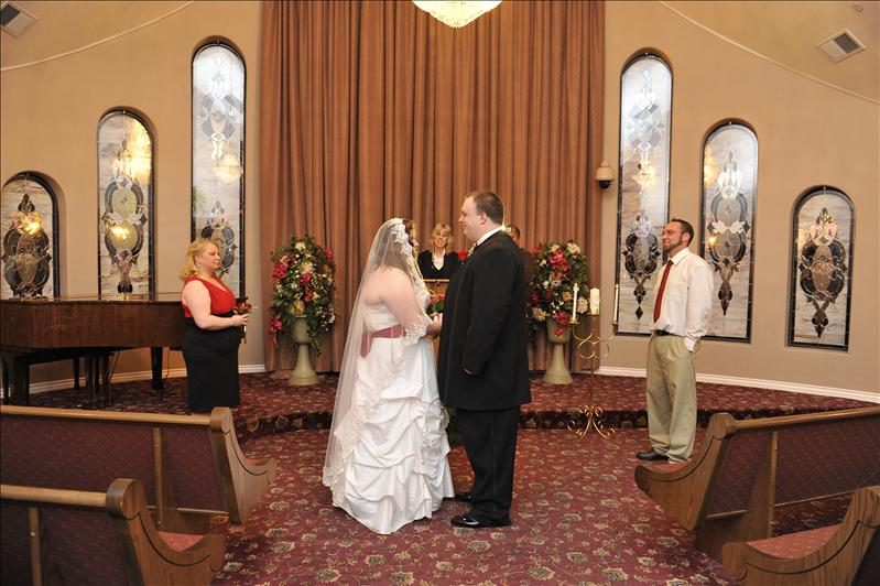Great shot of the party.  MAN that's alot of veil!!