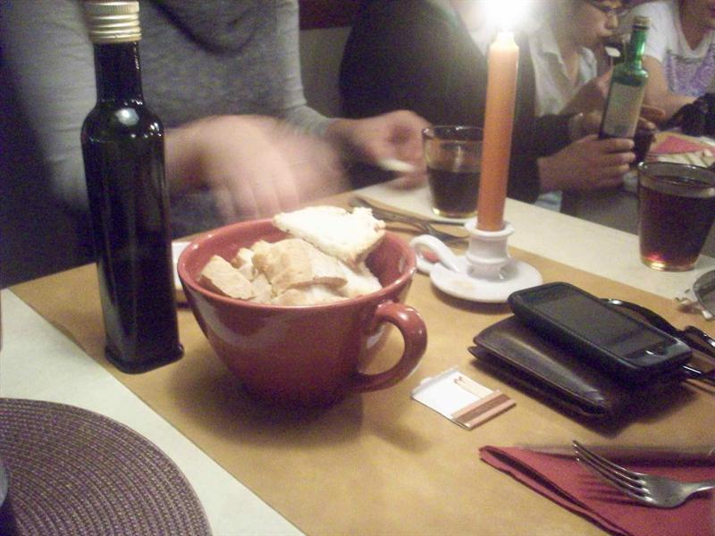 Enjoying vino bread and oil-vinegar