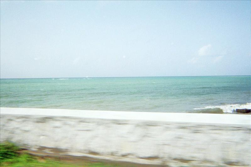 The ocean around the road