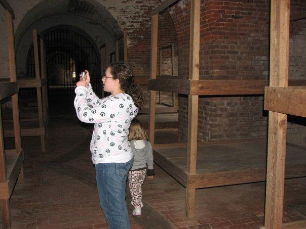 Picture of Taylor taking a picture inside the prisoners quarters.
