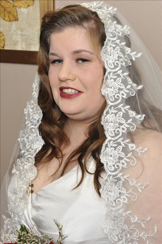 Pre-vows bridal suite portraits.  They all look weird cuz the guy told me to smile LESS!!