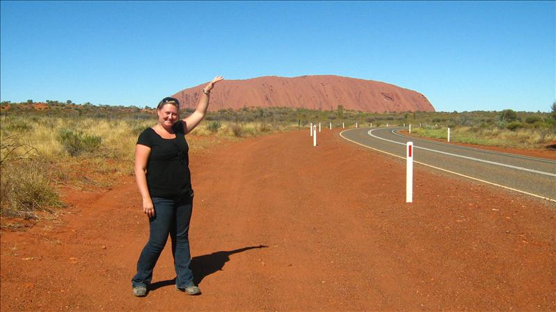 Me touching Uluru
