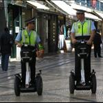 Segue policemen keep an eye on proceedings....