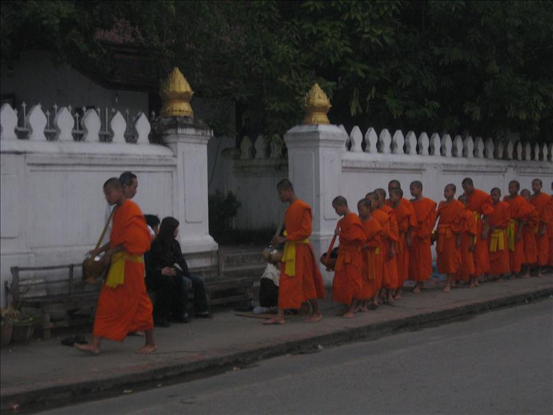 Village peole giving rice to the monks