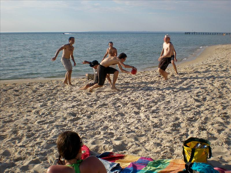 Playing beach aussie football