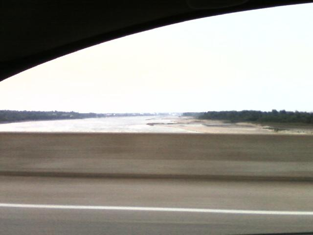 a poor view of the Mississippi river on the JB bridge