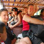 """Some were sitting on little wooden stools, some on bags of rice, a bit """"overcrowded"""", in line with local customs, but  we lived to tell the tale! :-)"""