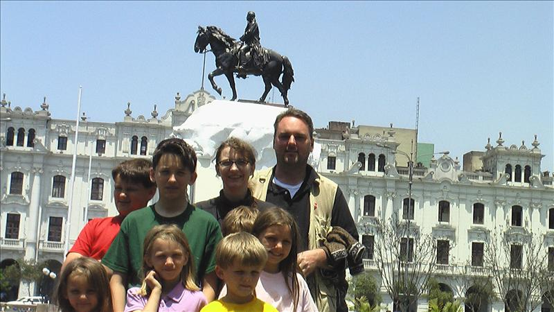 The family at a big square in Lima
