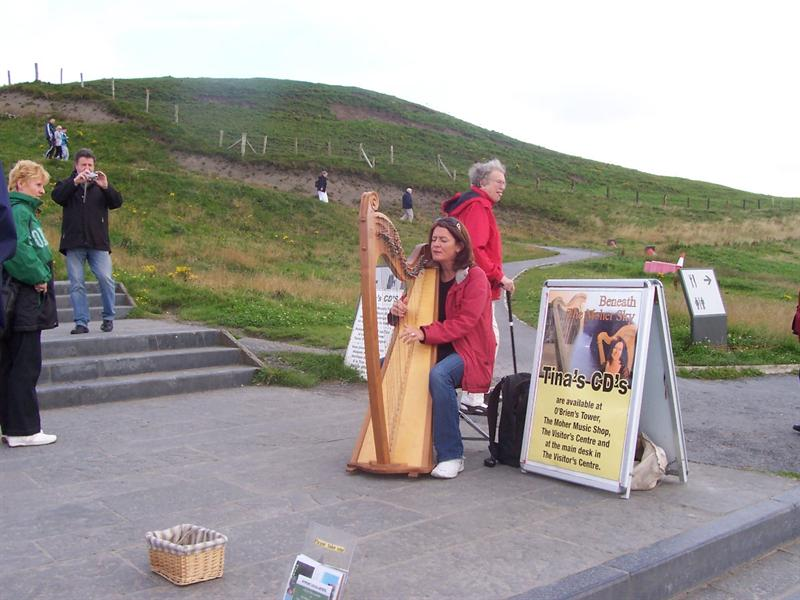Harpist at the Cliffs of Moher.