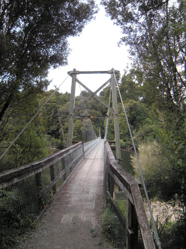 The long swing bridge over the river at Moana