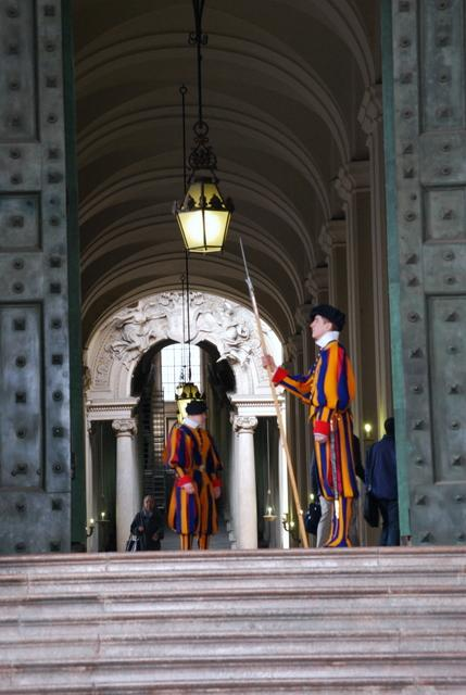 Will the Swiss Guard let him hold a place in the queue?