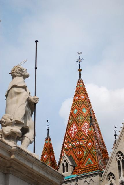 One of them gazes at the colourful roof of Matthias Church
