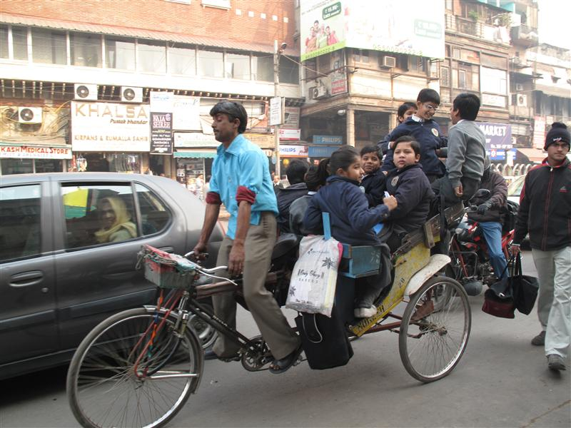 Kids on cycle rickshaw