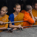 Monks traveling on river taxi