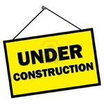9579863-under-construction-sign-hanging-from-nail-isolated-over-white.jpg