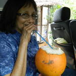 Mom drinking her sour young cocunut