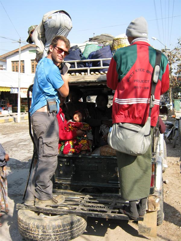 "7 hours standing on the back of the ""bus"" with 17 people on the jeep, on the way to Namshan, eating loads of dust"