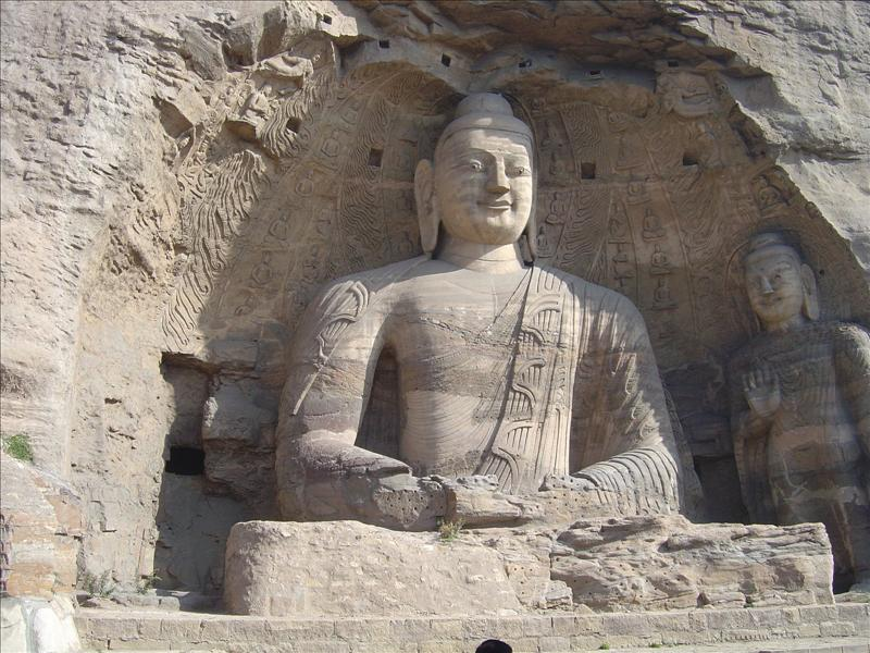 The largest stone buddha in the stone cave at Yungang measures 57.2 feet tall.           ng