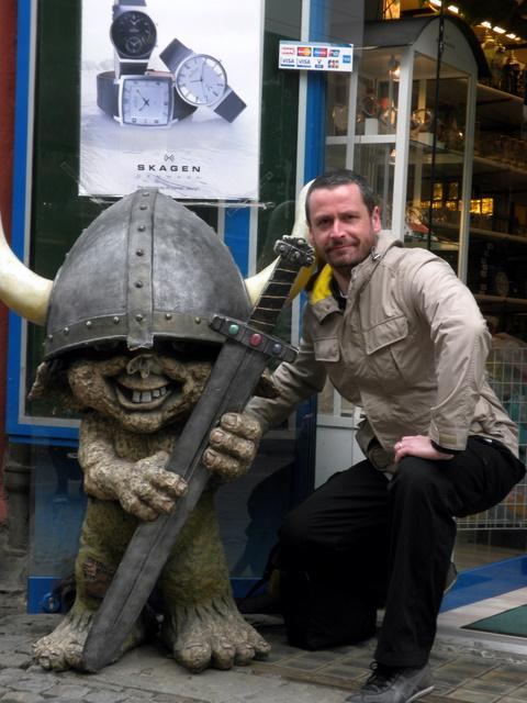 Simon looks confused and embarrassed by his new Viking friend