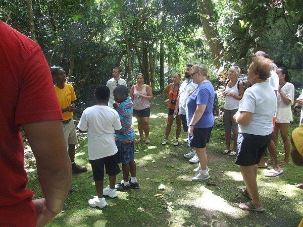A knowledge Adventureland 4x4 Tours guide talking at Welchman Hall Gully, Barbados