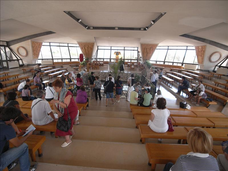 Interior of the Catholic Church built over the house of Saint Peter (enclosed in glass in the center