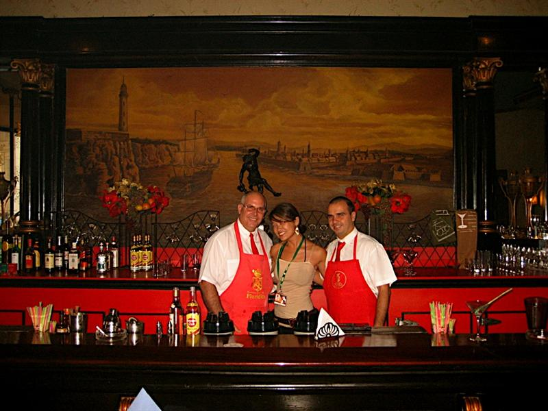 Standing behind the bar with my favorite bartenders. Here they are super friendly as they make a lot of tips. Waiters and bartenders at touristy venues are the highest paid and considered the highest in class, followed by Doctors and Professors, and finally owners of Casa Particulars. All other professions only average $10-13/month.