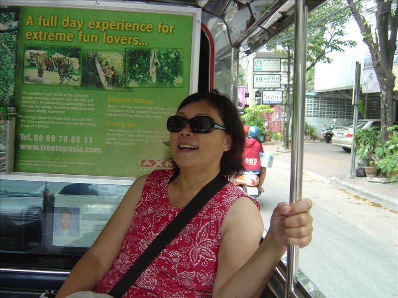 "fun riding in a street bus-like vehicle they call ""Tuk-Tuk"""