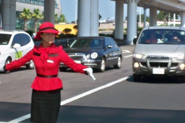 08/27 - on the way to jeju -   this was the traffic officer outside the airport.  she told you when you could cross and then bowed as you passed her.  it was pretty awesome