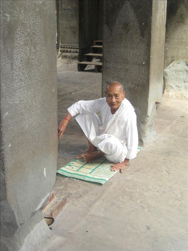 A nun sitting inside the temple.