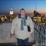 Me shivering on top of the Rock. Empire State building in background