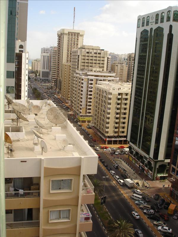 View of Hamdan Street from 13th floor. Our flat was at oposote side facing sea and was on 14th floor. Abu Dhabi, UAE.