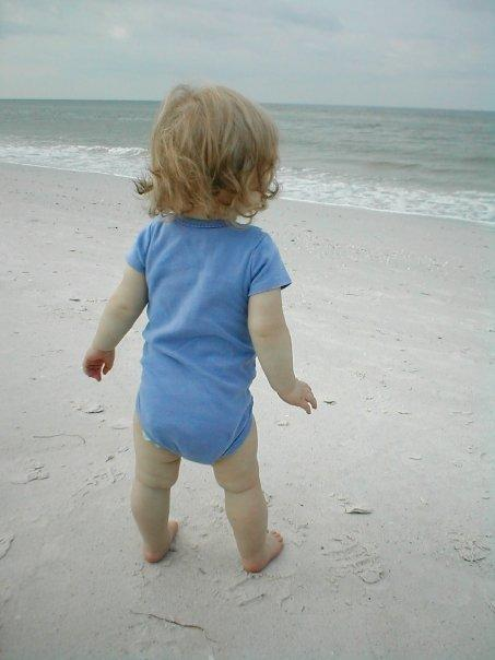 Katie's first steps on the beach! Not to sure about the sand. St Petersburg, FL