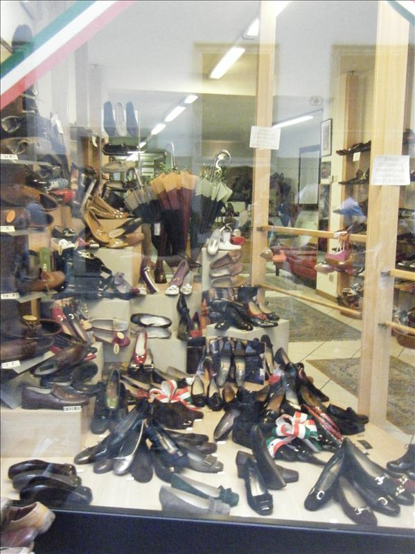 a bunch of shoes at a store