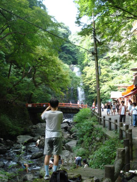 Man who is taking waterfall and waterfall