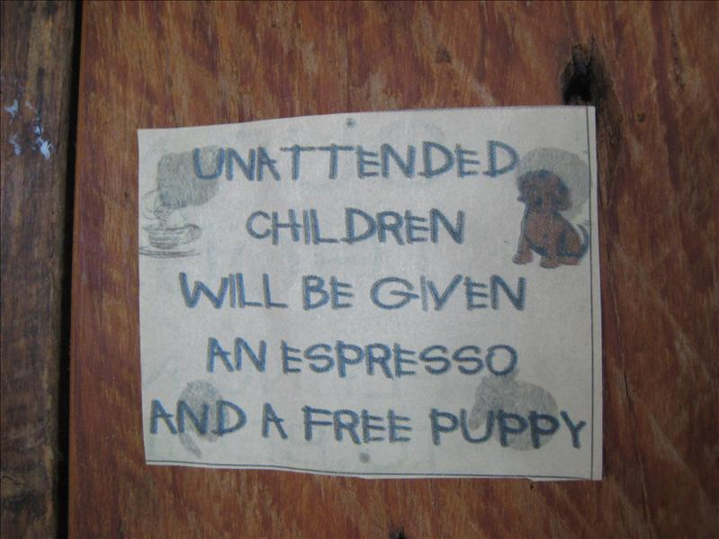Sign in a cafe in Hotianga :P abandoned kids get special treatment!