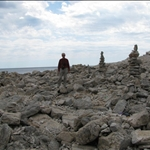 Stone cairns on the sea shore.
