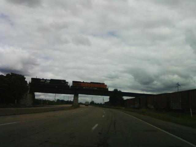 north bound on Hwy. 3, towards Alton Illnois, a train passes overhead