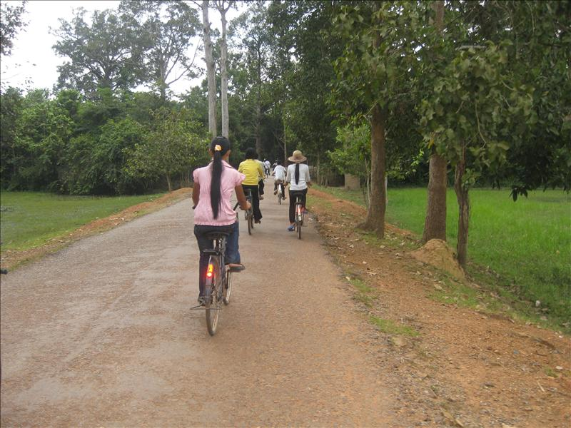 School girls cycling home from school