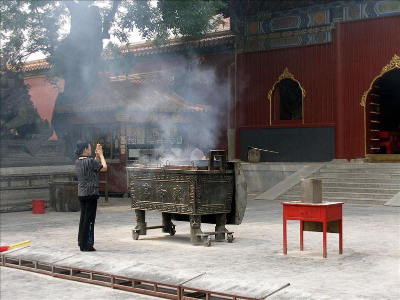 'Smoke get in her eyes' didn't bother her faith at all. Lama Temple, Beijing.