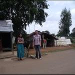 Gargi in Tamil Nadu, me in Karnataka, some very busy men in the background