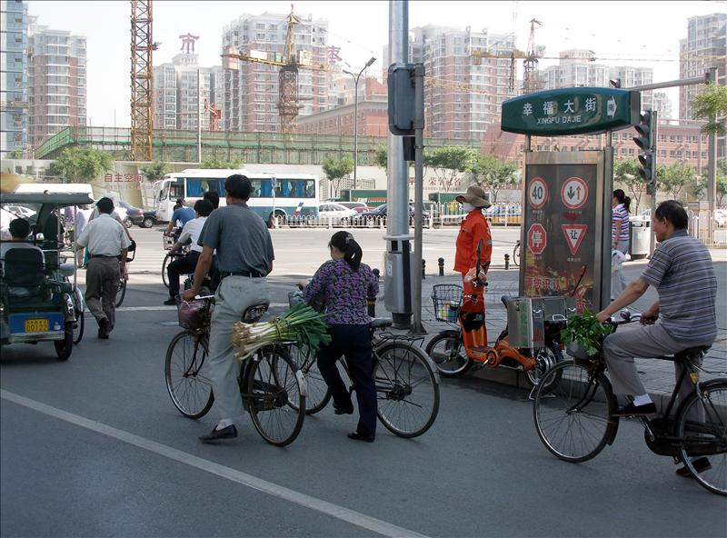 Morning traffic in Beijing, the guy in the front was chassing after his ranaway bike. Tons of hotels were under construction for the olympics. (day 2, Beijing)