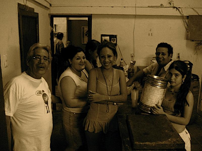 Victor (far left), and his fun and wacky family preparing a big feast for dad's 64th bday.