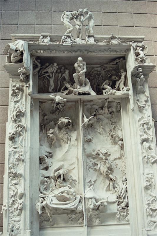 "La Porte de l'Enfer (translated The Gates of Hell) is a monumental sculptural group work by French artist Auguste Rodin that depicts a scene from ""The Inferno"", the first section of The Divine Comedy by Dante Alighieri. It stands at 6 m high, 4 m wide and 1 m deep (19.69'H � 13.12'W � 3.29'D) and contains 180 figures. The figures range from 15 cm high up to more than one metre. Several of the figures were also cast independently by Rodin."