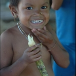 one of the little girls in the Geta village...she is eating sugar cane