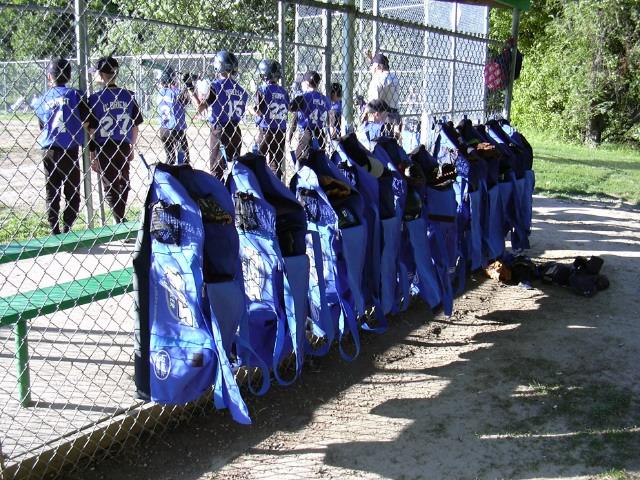 bags are hung on the backstop fence
