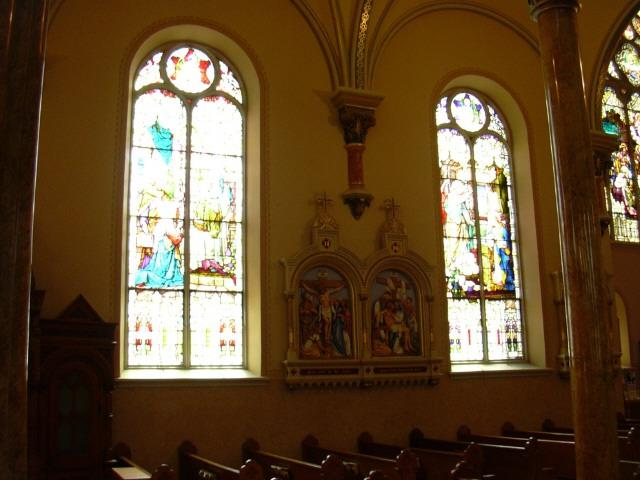 the stations of the cross and stained glass