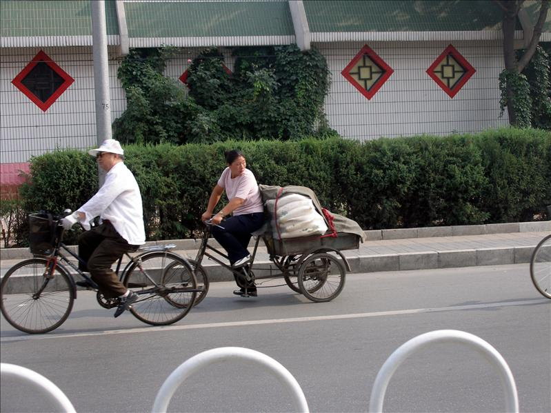 Eat my dust, 2-wheelers. Around our hotel in Bejing.